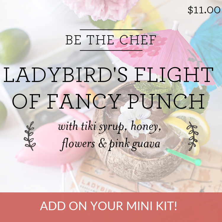 Ladybird's Flight Of Fancy Punch with tiki syrup, honey, flowers & pink guava